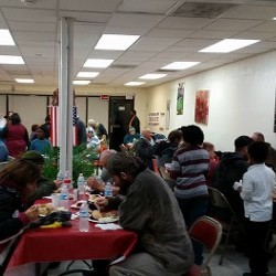 People Eating at in New Day Ministry