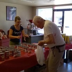 Volunteer Giving Client Canned Goods